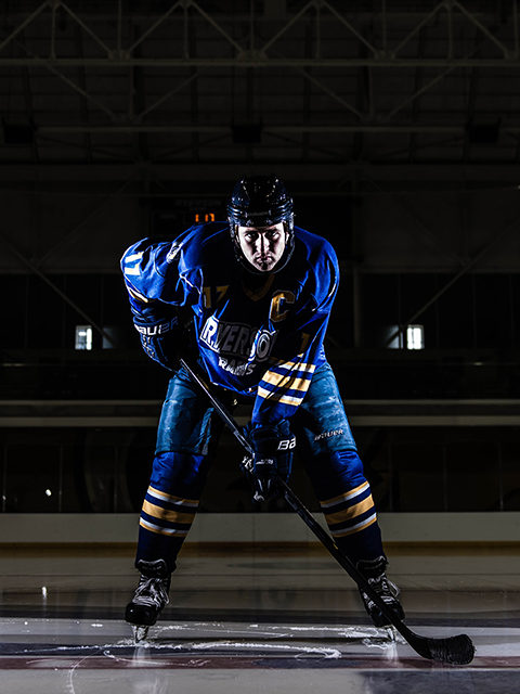 Andrew Buck poses at centre ice of the Mattamy Athletic Centre. Courtesy Winston Chow