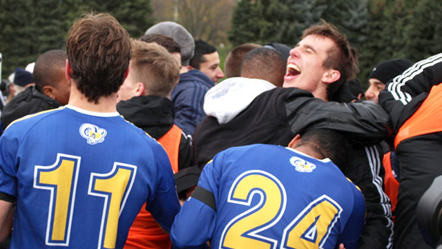 Ryerson's men's soccer team celebrates after defeating Windsor 1-0 in the OUA Final Four on Saturday, clinching their first-ever berth in the national championship tournament. (Dan Berlin / Ryersonian Staff)