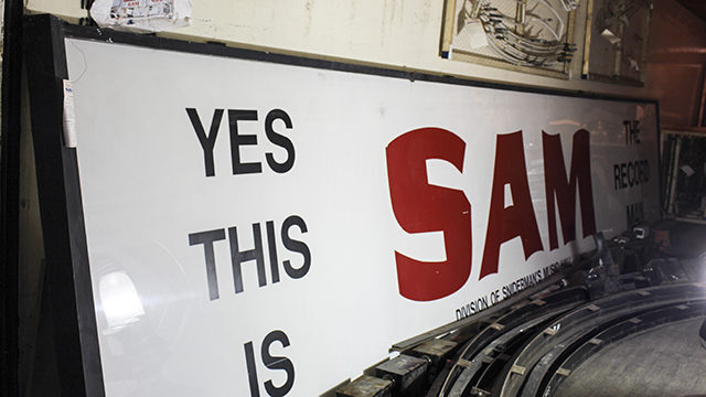 The white face of the iconic Sam sign rests against a wall in a tight container. (Arman Aghbali / Ryersonian Staff)