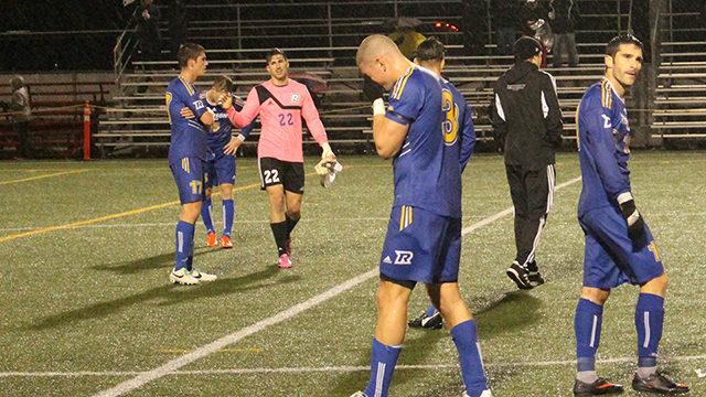 A dejected Jacob O'Connor (centre) following the Rams 3-2 loss to Laval in CIS quarter-finals. (Arman Aghbali/Ryersonian Staff)