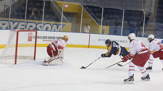 Left-wing Daniel Lombardi does his best Bobby Orr impression in an attempt to beat goalie Paul Dorsey on Nov. 15. (Nuruddin Qorane/Ryersonian Staff).
