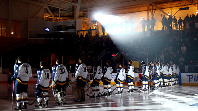 Rams players take in the national anthem before a game at the MAC. The Rams leave campus for a weekend double-header up north. (Photograph by Emma Ewing-Nagy, courtesy Ryerson Athletics)
