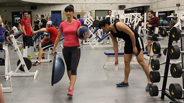 Ryerson student Angela Sucee exercises at the RAC. (Rebecca Sedore/The Ryersonian)