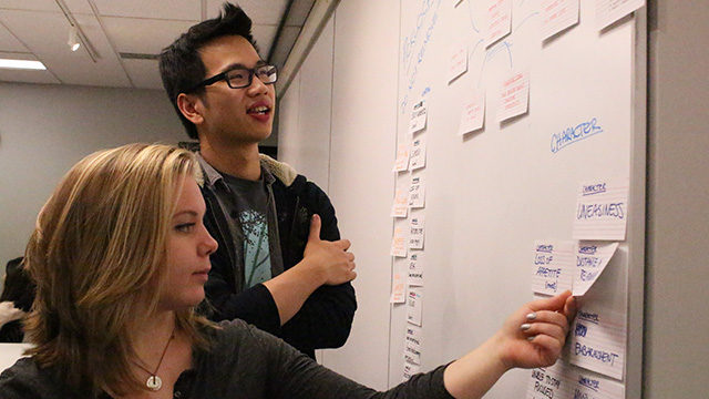 RTA students Kattie Laur and Anthony Suen are in the planning stage for their interactive documentary. (Rebecca Sedore / Ryersonian Staff)