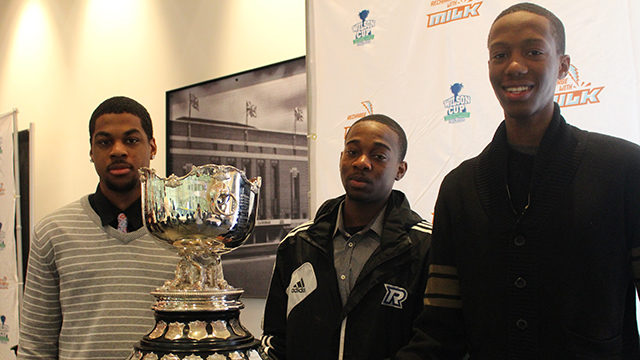 Adika Peter-McNeilly, Jahmal Jones and Jean-Victor Mukama stand next to the Wilson Cup. (Harlan Nemers/ The Ryersonian)