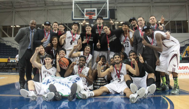 Ottawa Gee-Gees players celebrate after winning the OUA Wilson Cup at the Mattamy Athletic Centre. (Harlan Nemers/ The Ryersonian)