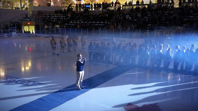 Andrea Bartlett sings the national anthem before a Rams hockey game.