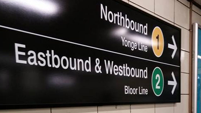 New numbered signs have popped up at Yonge-Bloor station as part of a pilot project. (Kelly McDowell/The Ryersonian)