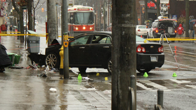 Shots were fired at Mutual and Gould streets early Friday morning. The victims fled and later crashed a bullet-ridden black Chevrolet Malibu into a pole at Parliament and Carlton Streets. (Leslie Walker / The Ryersonian)