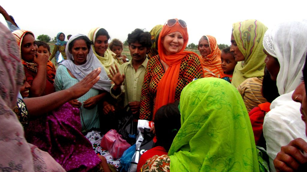The author's grandmother, Shadab Khatoon, distributing supplies during the 2010 Pakistan floods. (Fatima Kazmi/Ryersonian)