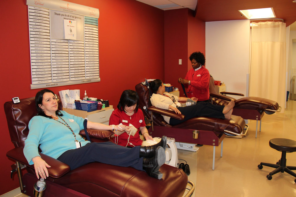 U.S. Consulate employees give blood at a Toronto clinic as part of President Obama's National Day of Service.