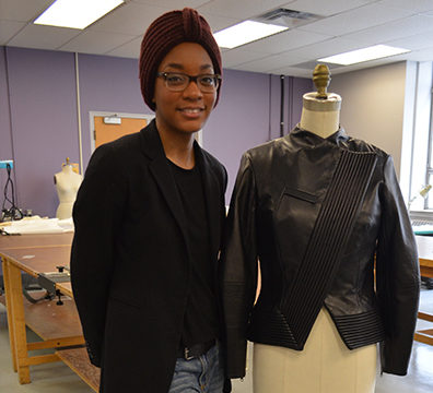 Chantelle Hastick with her winning design for the 2014 Danier Leather Design Challenge. (Hillary MacDonald/Ryersonian staff)