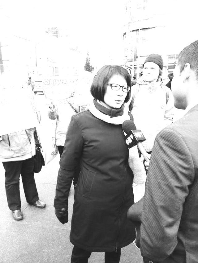 A photo of Olivia Chow in front of the Ryerson Students' Union, urging students to vote.
