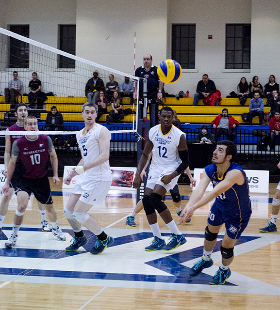 Anthony Cicchi attempts to save the ball for Ryerson in a match against the McMaster Marauders Nov. 19, 2014. (Rebecka Calderwood / Ryersonian Staff)