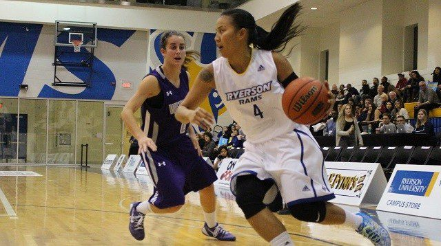 Ryerson Rams' Chloe Mago dribbles around a Western defender Wednesday, Nov. 12, 2014. (Alexis Allison / Ryersonian Staff)