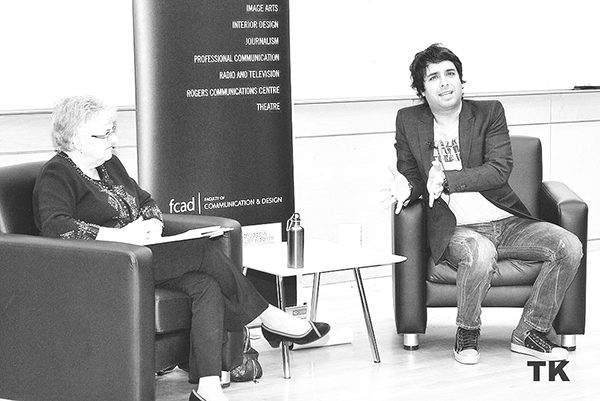 Jian Ghomeshi speaks with Ryerson journalism professor Suanne Kelman at a Ryerson event in 2010.