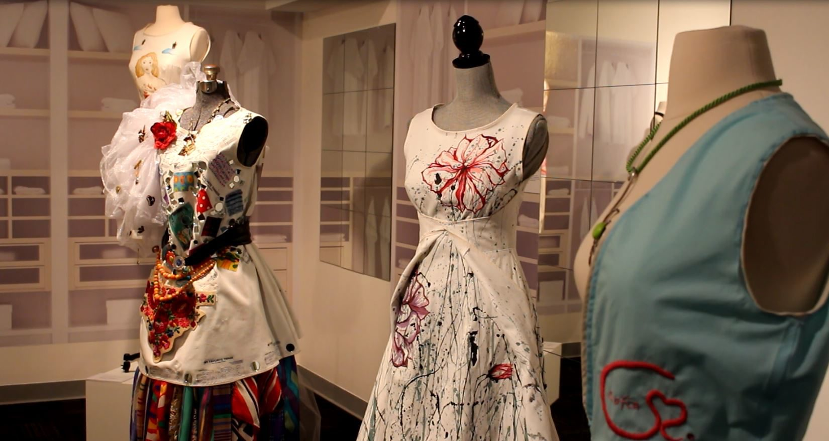 Three of 14 dresses on display at the Toronto exhibit. (Caroline Dinnall / Ryersonian Staff)