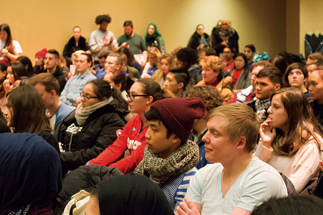 Students watch as RSU election candidates make their opening statements. (Kyla Dewar / Ryersonian Staff)
