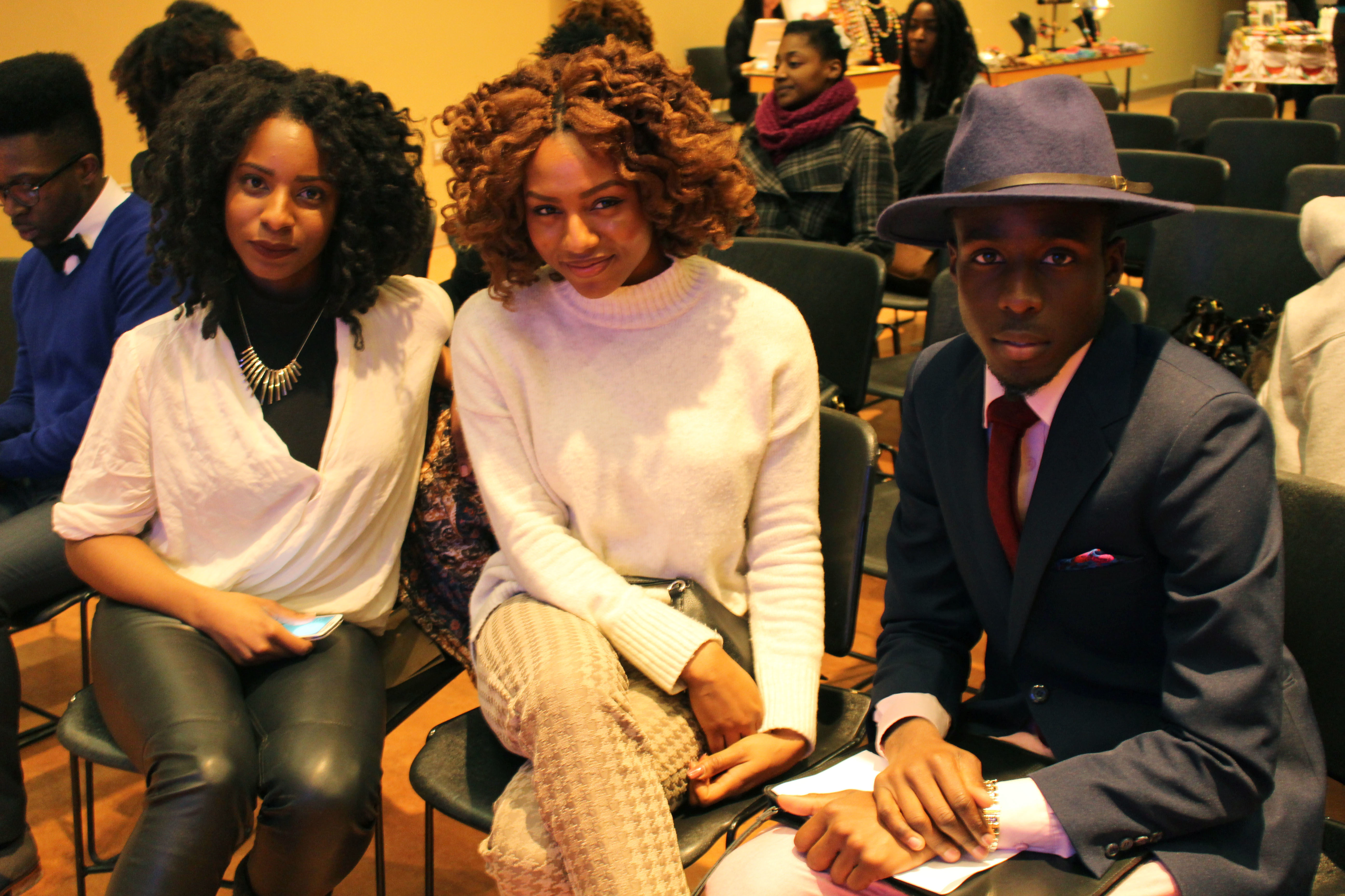 Jalen 'LickMyFashion' Nelson (right) sits with guests of My Hair, My Look, My Swag event. (Caroline Dinnall / Ryersonian Staff)