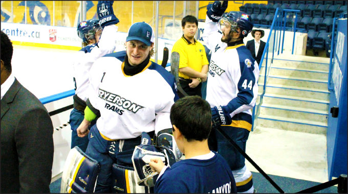 Rams hockey players heading onto the ice at a game earlier this year. (Kalia Garcia-Rojas/Ryersonian Staff)