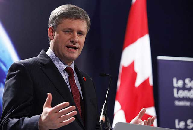 In this Apr. 2, 2009, file photo, Prime Minister Stephen Harper addresses media at the London Summit in London, England. (Courtesy of Richard Lewis/newsteam.co.uk)