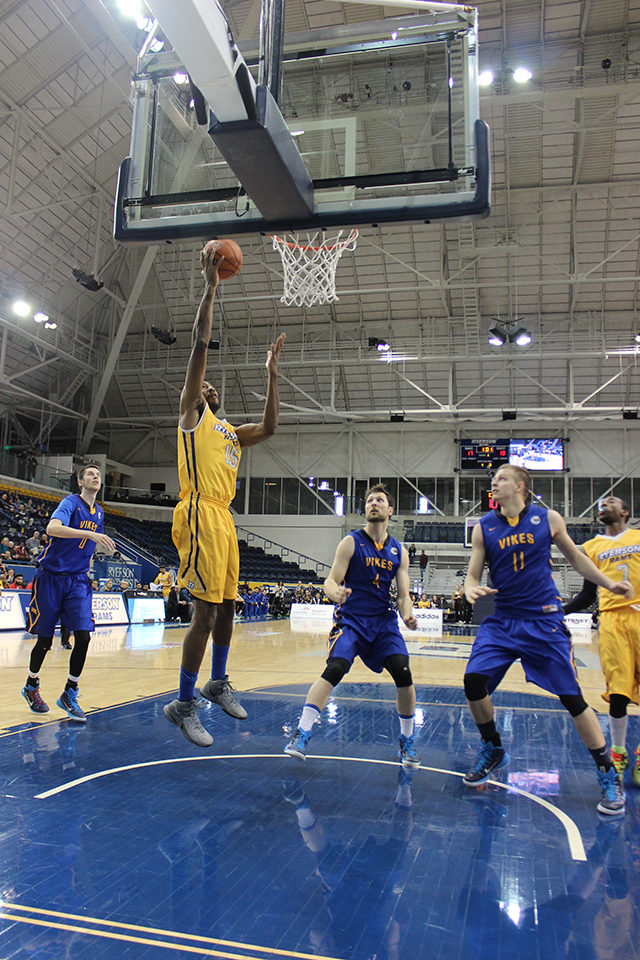 Kadeem Green from the Ryerson Rams scores in the first half of the bronze medal game. (Courtesy of Marija Petrovic/Ryersonian Staff)