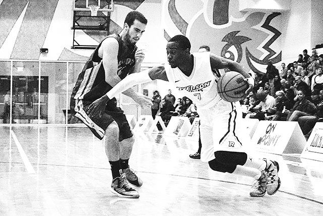The Ryerson men's basketball team beat the Laurier Golden Hawks 105-59 in the 2015 CIS quarter-finals at the Mattamy Athletic Centre. (Ryersonian Staff)