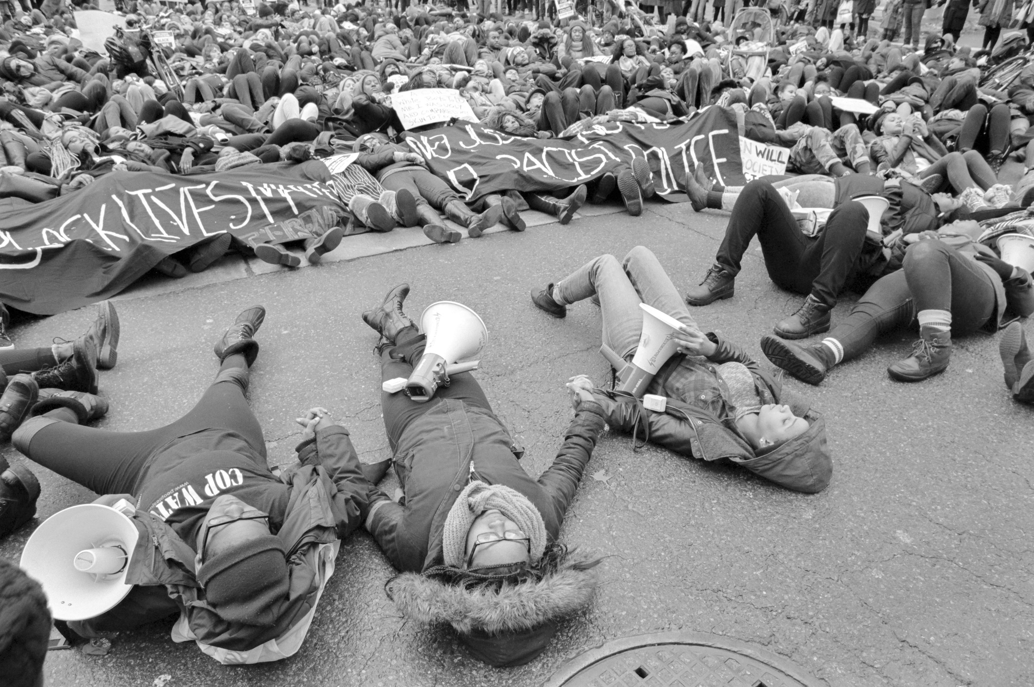 Black Lives Matter TO protesters lay down in solidarity for Michael Brown at Yonge & Dundas (Kevin Jones)