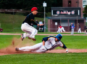 Ryerson Rams baseball player makes a diving play at Talbot Park. (Courtesy Winston Chow)