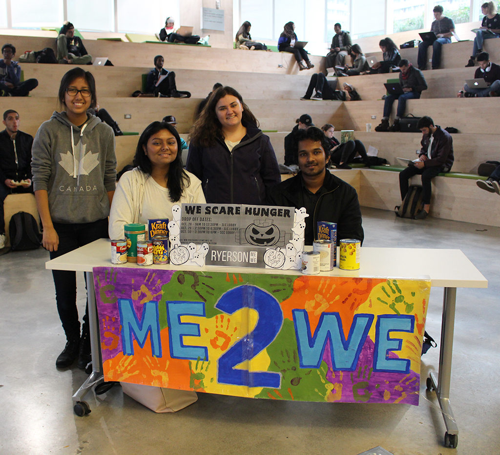 "Members of Ryerson Me To We taking donations at the SLC on Oct. 28, 2015, the first day of the ""We Scare Hunger"" campaign. (Robert Liwanag/Ryersonian Staff)"