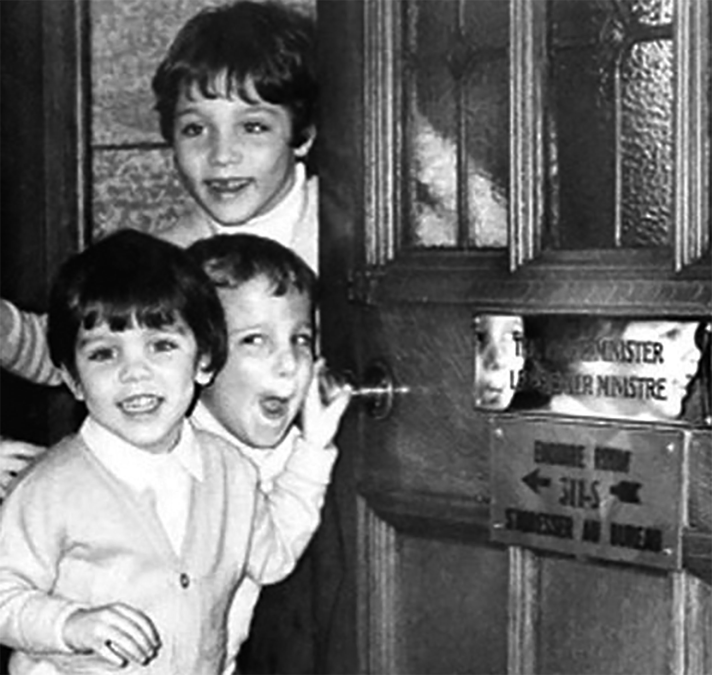 Justin with brothers Michel and Alexandre 'Sacha' peek out of their father's office in 1978.