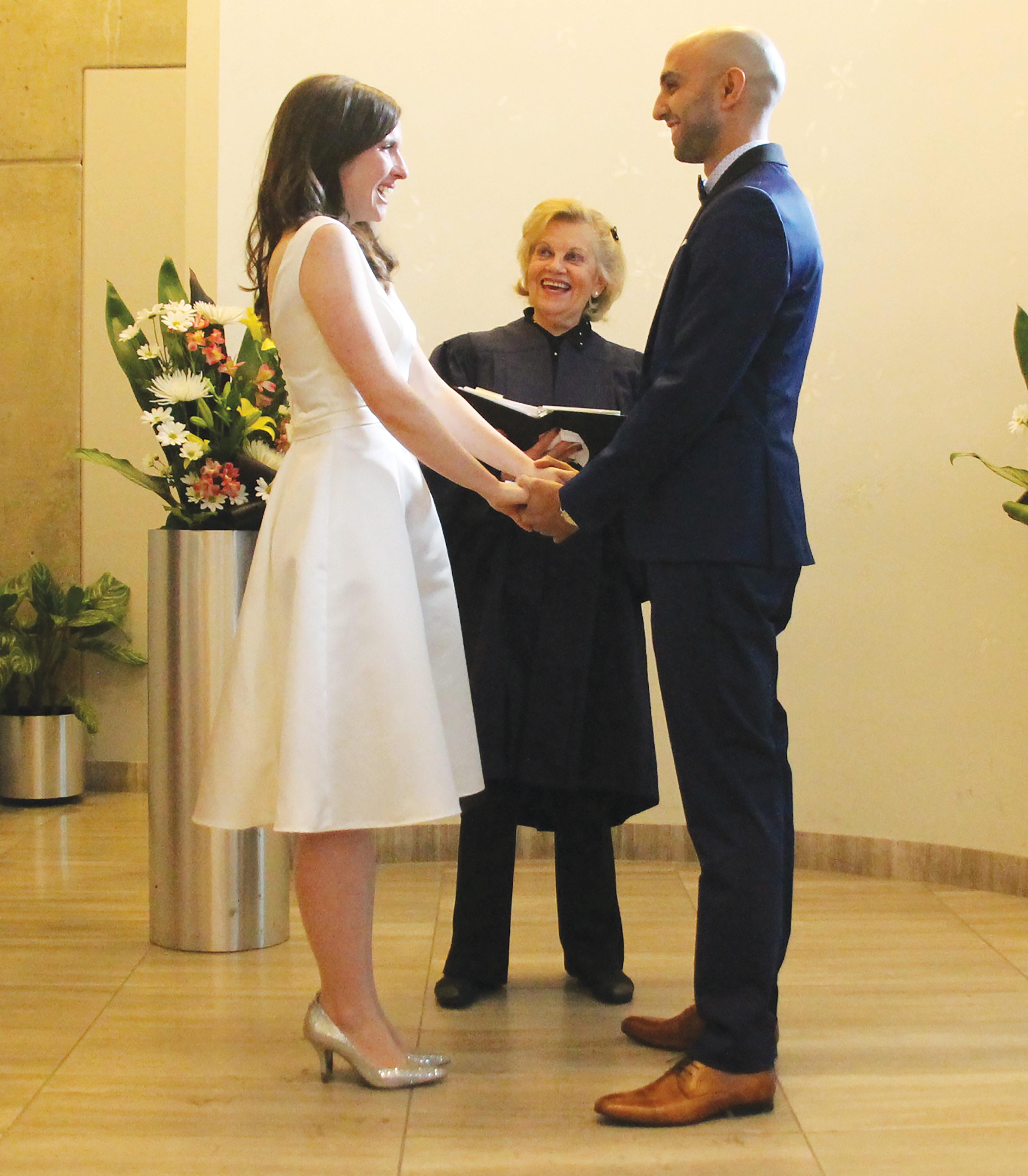 Jackson and Yousefian getting married at city hall. Courtesy Samatha Jackson.