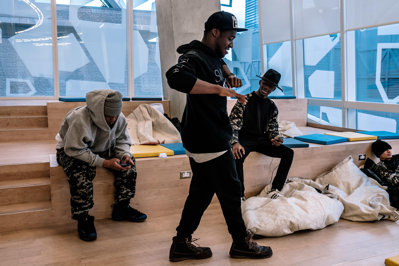 A student dances on the sixth floor of the new Student Learning Centre opened in February. (Steven Goetz/Steven Goetz Storytelling)
