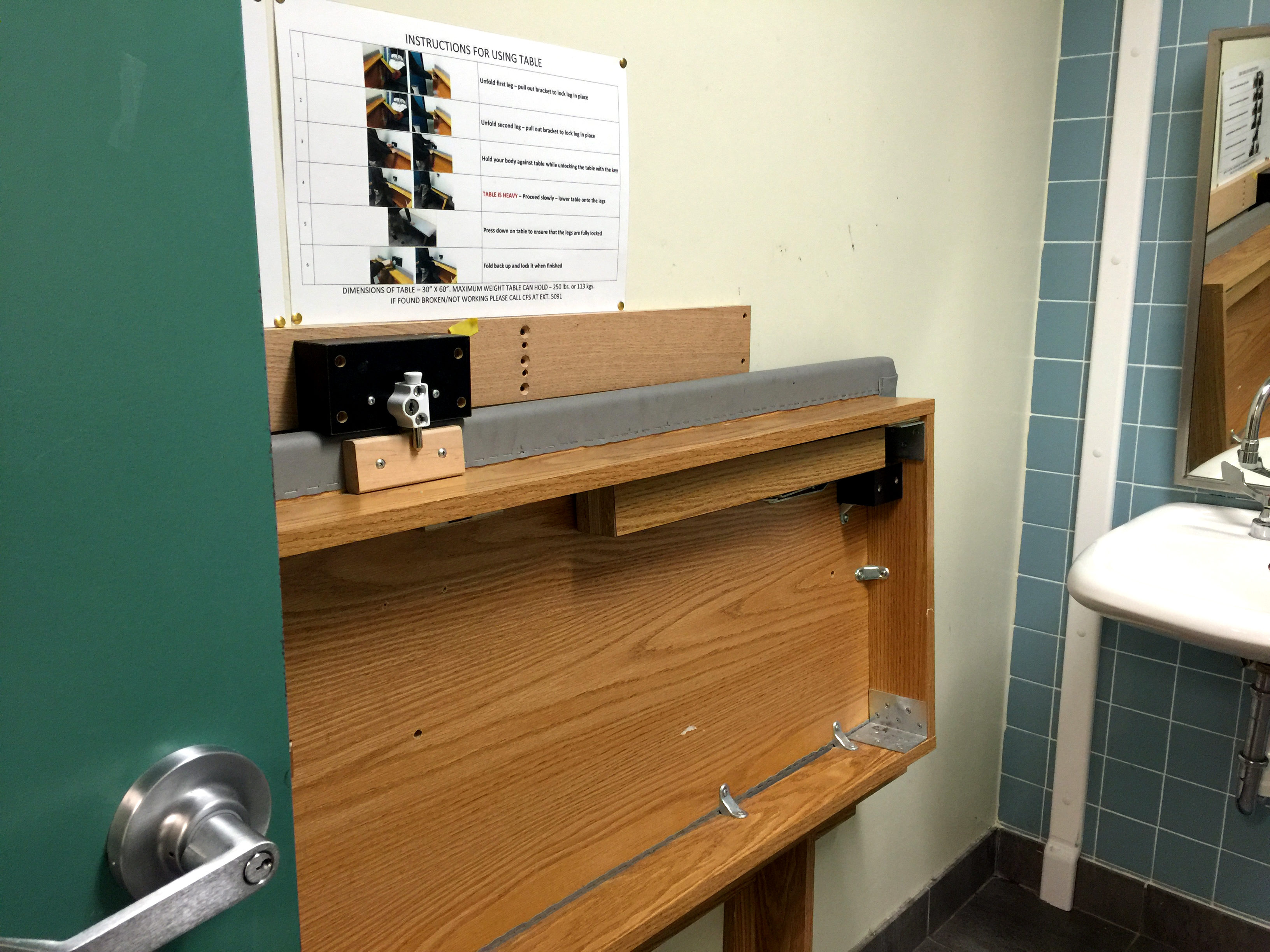 The cot propped up in the accessible washroom where the man was found Nov. 4, 2015. (Latifa Abdin/Ryersonian Staff)