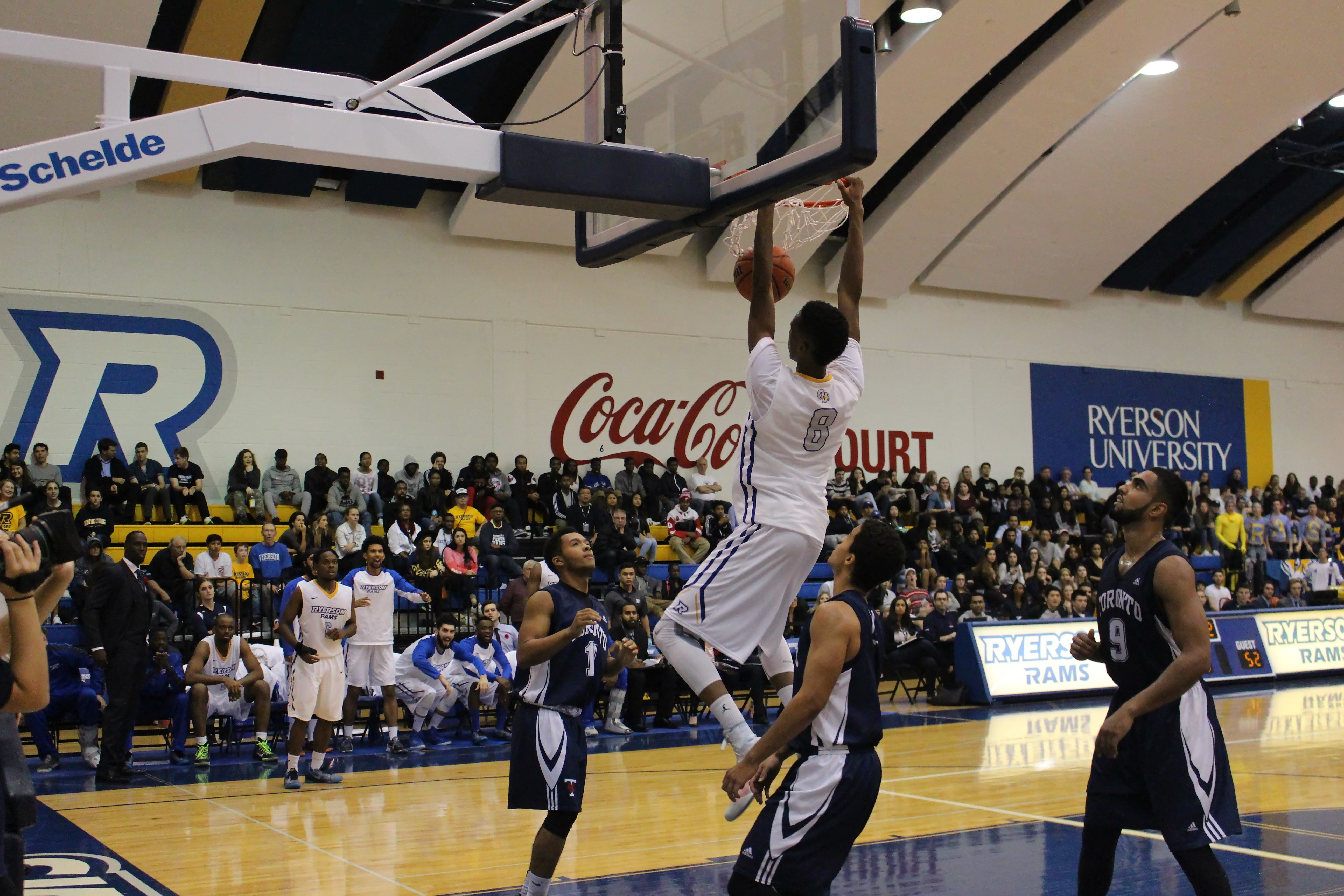 Guard Jean-Victor Mukama makes a slam dunk in the BIA Cup opening game (Andrea Vacl/Ryersonian staff)