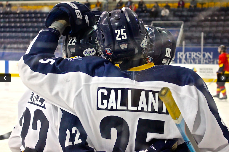 Gallant and his teammates exchange some love (Christian Thomson/Ryersonian Staff).