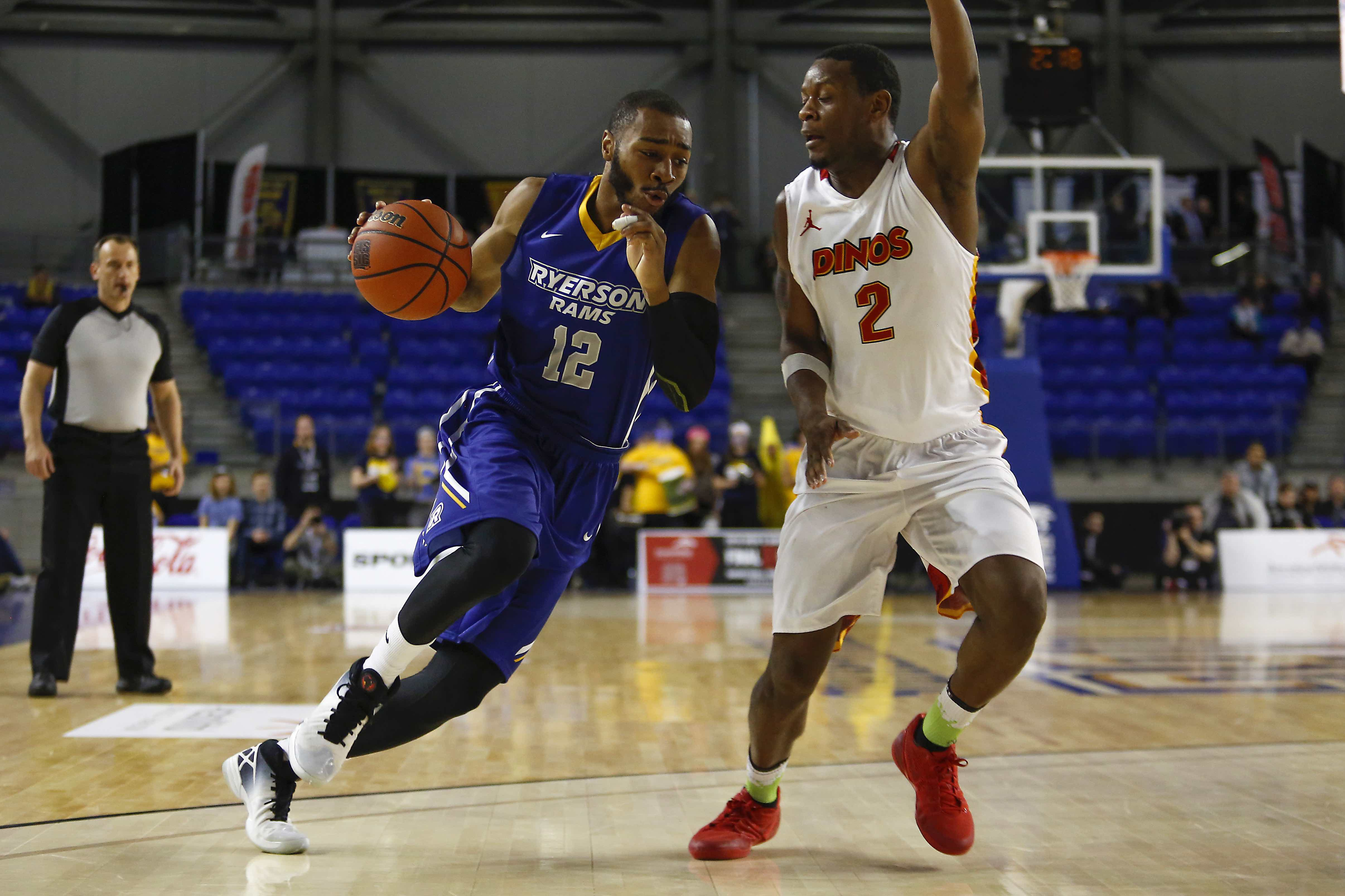Rams Aaron Best (12) drives on Dinos Thomas Cooper (2) in CIS semifinal. (Courtesy Alex D'Addesse/Rams Athletics)