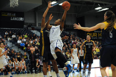 Co-captain Keneca Pingue-Giles drives to the rim against the Windosr Lancers.(Ryerson Staff)