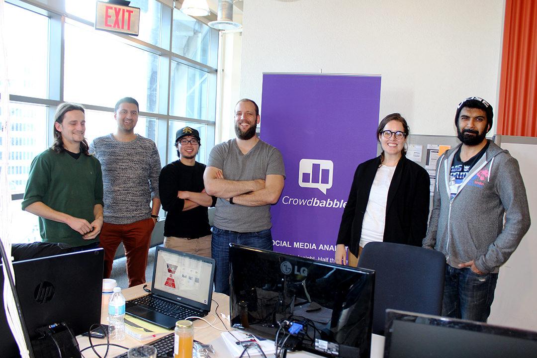 Team Crowdbabble poses in their DMZ office on March 28. (Erin Hesselink/Ryersonian Staff)