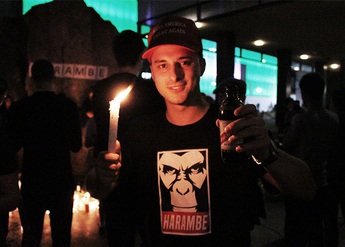 Some attendees brought beers and other substances to Harambe's vigil at Lake Devo. (Andrea Vacl)