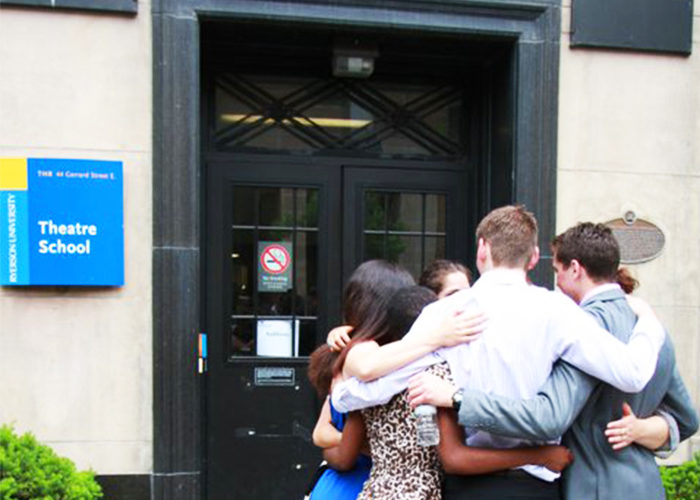 An embrace outside the theatre school on convocation day. (Courtesy Milena Georgieva)