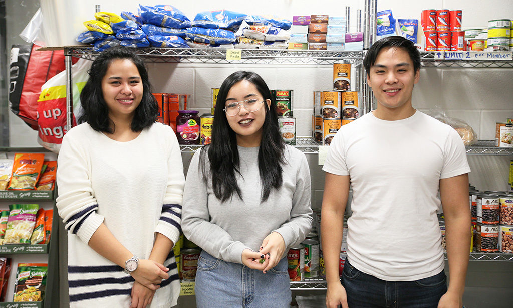 Volunteers at the Ryerson Good Food Centre: Zennia Seneres, Renee Labrido and Evan Tang. (Samraweet Yohannes)