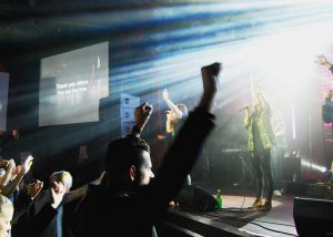 Pastor Jeff Pike and his congregation at the Mod Club during the Groundswell Sunday morning service. (Jennie Pearson)