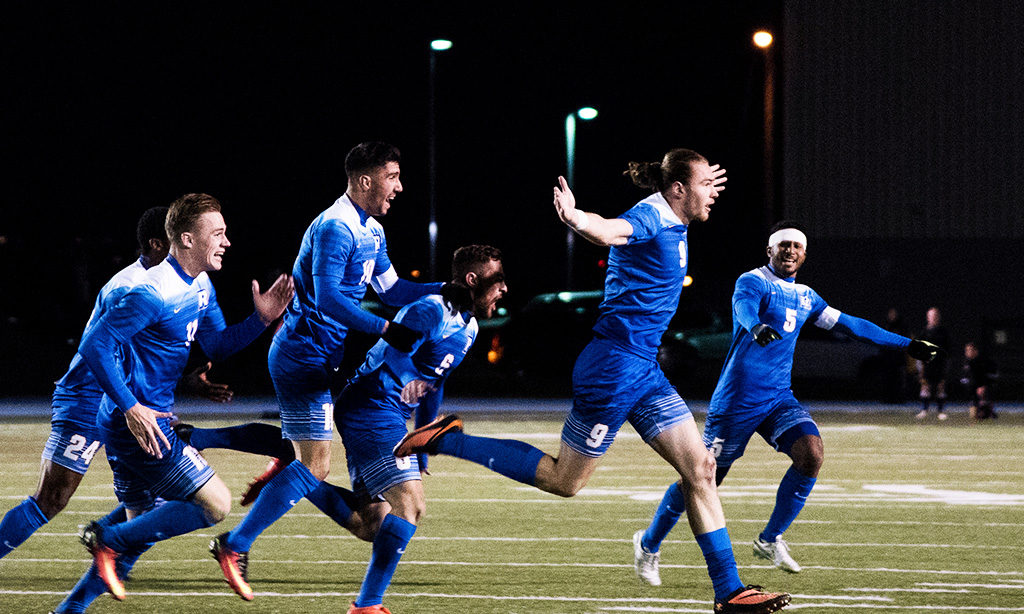 The Ryerson Men's soccer team celebrates Jamie Baker's game-winning goal on Sunday during their quarterfinal match-up. (Tagwa Moyo)