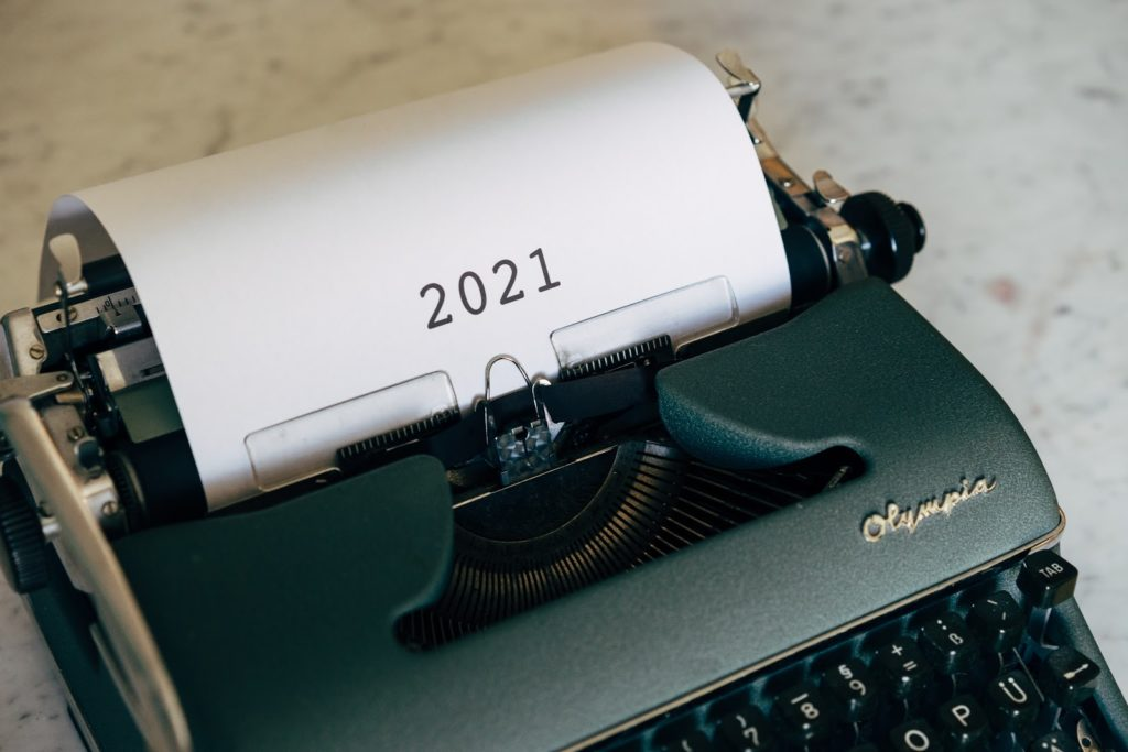 a typewriter that has the year 2021 written on a paper attached to it