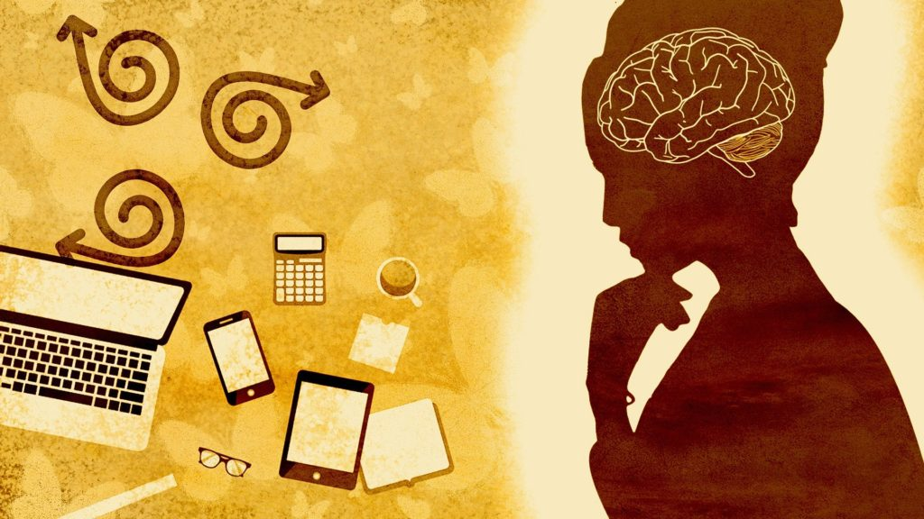 a cartoon image of a silhouette of a person thinking with their brain visible and a laptop and phones on their left-hand side